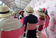 Contestants of the Longines Kentucky Oaks Day fashion contest walk the pink carpet for the chance to win a Longines DolceVita timepiece, Friday, May 6, 2016 in Louisville, KY. Longines, the Swiss watch manufacturer known for its elegant timepieces, is the Official Watch and Timekeeper of the 142nd annual Kentucky Derby. (Photo by Diane Bondareff for Longines/AP Images)