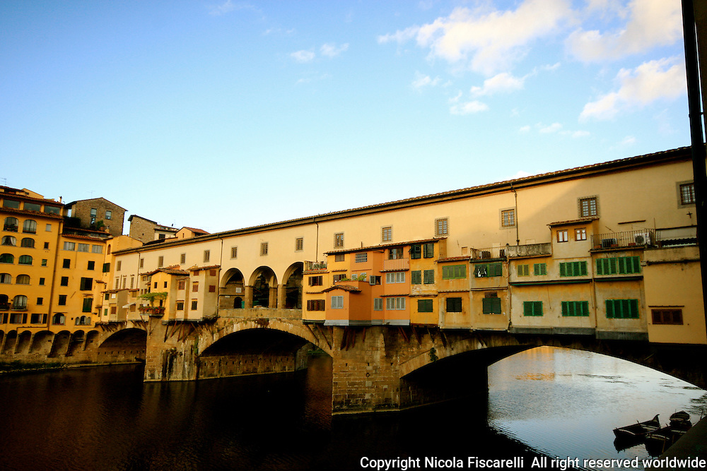 "The Ponte Vecchio is one of the most visited tourist sites in the renaissance city  of Florence Italy. It is line on both sides with jewelry shops and above them is part of the Famous""Vasari corridor""."