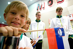 Young fan with Slovenian flag, Tim Matavz and Milivoje Novakovic at visit  of Slovenian National Football team in Mobitel center, on May 19, 2010 in Ciytpark, BTC, Ljubljana, Slovenia. (Photo by Vid Ponikvar / Sportida)