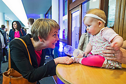 © London News Pictures. 16/05/2015. Yvette Copper meets 6 month old Betsie as she arrives at Progress Annual Conference held at TUC Congress House in London to discuss the labour leadership race following a heavy defeat in the recent general election..  Photo credit: Ben Cawthra/LNP
