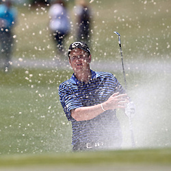 Apr 26, 2012; Avondale, LA, USA; J.J. Henry hits from a sand trap on the 18th hole during the first round of the Zurich Classic of New Orleans at TPC Louisiana. Mandatory Credit: Derick E. Hingle-US PRESSWIRE