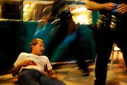 SANTA MONICA, CALIFORNIA. AUGUST 29, 2006. Santa Monica Police officers assist an unidentified homeless man who was stabbed in the stomach at the third street promenade in Santa Monica, CA. on August 29, 2006. Three hours later, Santa Monica Police stoped a man who fit the description named Ian Mcnulty and arrested him for attempted murder. The city of Santa Monica has been having a rise in crime mostly due to its high population of homeless people. Spot News, General News images for Newspapers by Photojournalist Pablo Robles.