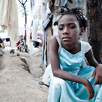 A girl sits in a tent city for those displaced by the January 2010 earthquake.