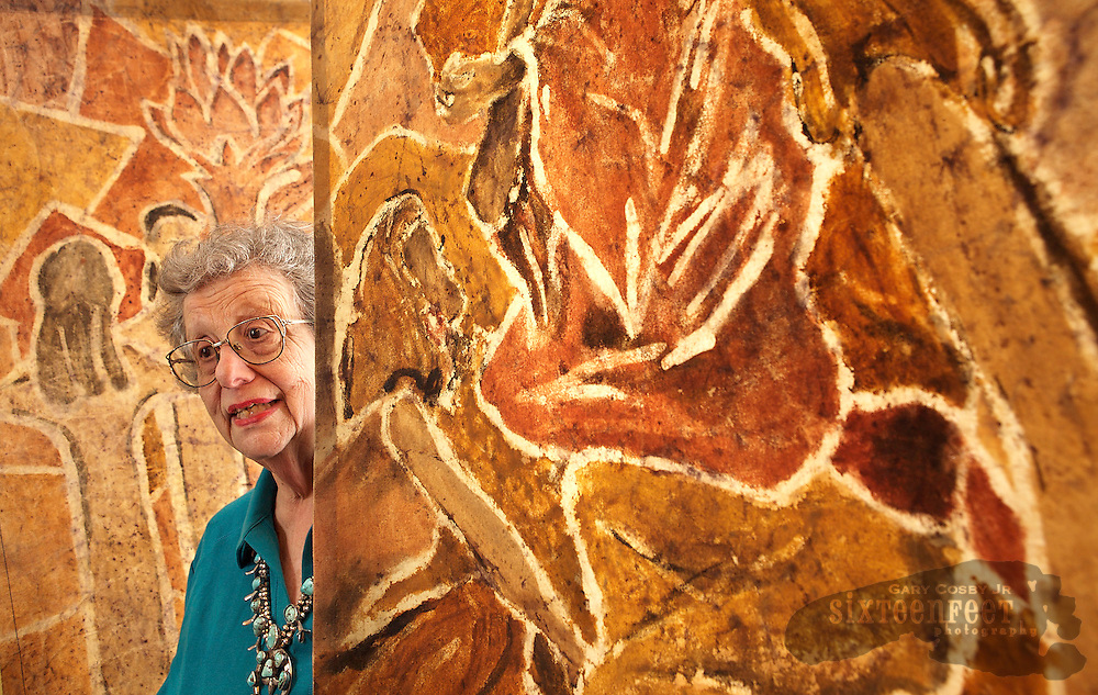 Photo by Gary Cosby Jr.  Jean Schulman poses between two of her batiks at her home in Florence, AL Tuesday, March 4, 2008.  Schulman, 80, created the art by taking clay she has collected around the south and painting it onto fabrics.  The resulting art is a unique form of batik that has earned her a spot in the Smithsonian Institution's National Museum of American History.