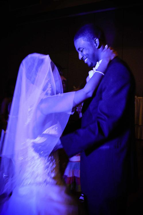 Cassie & Ernest cast in romantic blue light during their first dance at Dinolfo's Banquet Hall in Homer Glen, IL