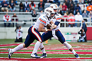 FAYETTEVILLE, AR - OCTOBER 31:  Jarod Neal #13 hands off the ball to Trent Garland #22 of the UT Martin Skyhawks during a game against the Arkansas Razorbacks at Razorback Stadium on October 31, 2015 in Fayetteville, Arkansas.  The Razorbacks defeated the Skyhawks 63-28.  (Photo by Wesley Hitt/Getty Images) *** Local Caption *** Jarod Neal
