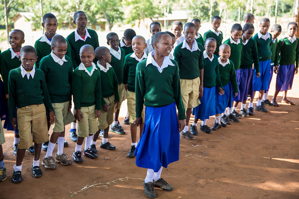 The pupils of Endagikot school sing a song at the end of their ICS Raleigh SWASH (school water, sanitation and hygiene plan) project. Mbulu, Manyara district, Tanzania. Working in partnership with the Diocese of Mbulu Development Department (DMDD); part of Caritas Tanzania.