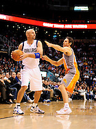 Mar. 08, 2012; Phoenix, AZ, USA;  Dallas Mavericks guard Jason Kidd (2) handles the ball against the Phoenix Suns guard Steve Nash (13) during the first half at the US Airways Center.  Mandatory Credit: Jennifer Stewart-US PRESSWIRE.