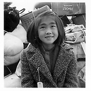 Hayward, Calif.--A young member of an evacuee family awaiting evacuation bus. Evacuees of Japanese ancestry will be housed in War Relocation Authority centers for the duration. -- Photographer: Lange, Dorothea -- Hayward, California. 5/8/42<br /> Identifier:<br /> Volume 59<br /> Identifier:<br /> Section G<br /> Identifier:<br /> WRA no. C-159<br /> Collection:<br /> War Relocation Authority Photographs of Japanese-American Evacuation and Resettlement Series 14: Preevacuation<br /> Contributing Institution:<br /> The Bancroft Library. University of California, Berkeley.