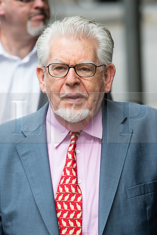 © Licensed to London News Pictures. 23/06/2014. London, UK. Artist and television personality, Rolf Harris arrives at Southwark Crown Court in London on 23rd June 2014. Rolf Harris denies 12 counts of indecent assault against four girls and women between 1968 and 1986. Photo credit : Vickie Flores/LNP