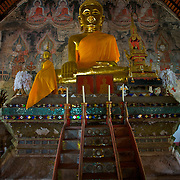The principle Buddha at the Wihan of Wat Nong Bua in Nong Bua village of Tha Wang Pha district, Nan, Thailand, was built by Thai Lu craftsmen who had earlier migrated from southern China. The Wihan  is adorned with elaborate carvings, there are also wall murals painted by Thai Lu artists some one hundred years ago.