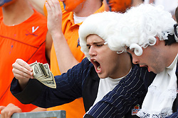 Nov 26, 2011; Charlottesville VA, USA;  Virginia Cavaliers fans dressed as founder Thomas Jefferson (not pictured) wave two dollar bills before the game against the Virginia Tech Hokies at the Scott Stadium.  Mandatory Credit: Jason O. Watson-US PRESSWIRE