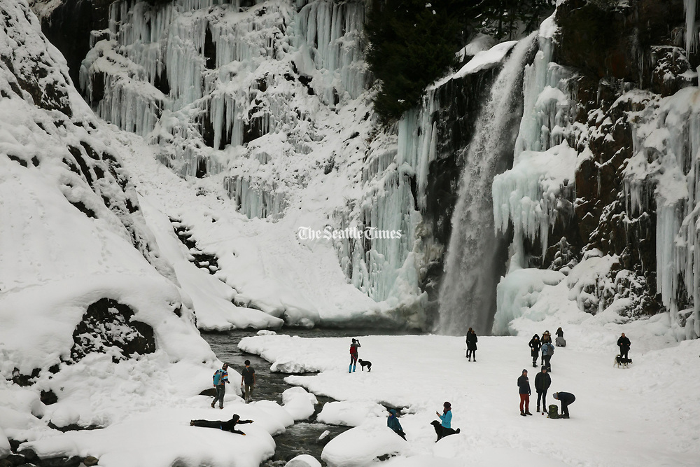 Families and groups explore Franklin Falls near the Exit 47 Denny Creek/Tinkham Road Exit off of Interstate 90 outside of North Bend. (Erika Schultz / The Seattle Times)