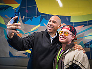27 NOVEMBER 2019 - DES MOINES, IOWA: US Senator CORY BOOKER (D-NJ) records a Snapchat video after lunch at Central Iowa Shelter and Services in Des Moines. They had to bump elbows rather than shake hands because Sen Booker was wearing gloves to handle food. Sen Booker helped plate up and serve lunch at the shelter. The shelter has about 180 beds and is full almost every night. In January and February, more than 250 people per night come to the shelter, which sets out overflow bedding. Senator Booker is running to be the Democratic nominee for the US Presidency in 2020. Iowa hosts the first selection event of the presidential election season. The Iowa caucuses are February 3, 2020.        PHOTO BY JACK KURTZ