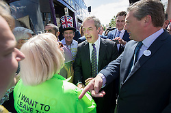 © Licensed to London News Pictures. 20/06/2016. Clacton-on-Sea, UK . UKIP party leader Nigel Farage meets a woman wearing an 'I want to leave the EU' t-shirt as he campaigns for Brexit in the last few days of the EU referendum. Photo credit: Peter Macdiarmid/LNP