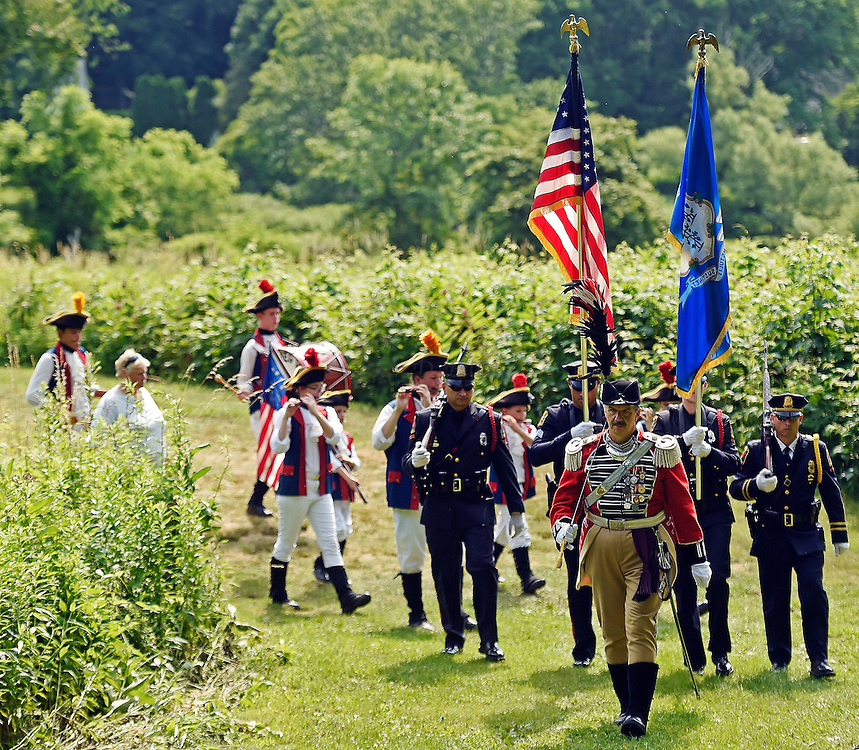 7/1/16 :: REGION :: BESSETTE :: Major Mark Boudreau, of the First Company Governor's Foot Guard leads the color guard from the Norwich Police Department and the Nutmeg Volunteers Fife and Drum Corps to present the colors at the annual wreath-laying at the grave of Samuel Huntington Friday, July 1, 2016 at the Historic Norwichtown cemetery in Norwich. Huntington was a signer of the Declaration of Independence and served as first President of the United States under the Articles of Confederation, the governing documents that preceded the constitution. (Sean D. Elliot/The Day)