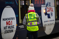 "© Licensed to London News Pictures . 05/01/2019. Manchester, UK. A woman wearing a "" No Deal Brexit "" hi vis vest . A Yellow Vest demonstration takes place in St Peter's Square in central Manchester . The protest was organised via YouTube account "" Tommy Robinson News "" and was called in the wake of stabbings at Manchester Victoria Train Station on New Year's Eve . Protesters chanted in favour of Brexit , against police and press and carried pro-Trump and EDL clothing and placards . Photo credit : Joel Goodman/LNP"