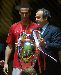 MOSCOW, RUSSIA - Wednesday, May 21, 2008: Manchester United's Rio Ferdinand receives the European Cup from UEFA President Michel Platini after the UEFA Champions League Final against Chelsea at the Luzhniki Stadium. (Photo by David Rawcliffe/Propaganda)
