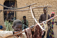 Children in the courtyard of a family household in the Maradi region of southern Niger. Located in the Western Sahel, the landlocked country suffers from chronic malnutrition and food insecurity caused by climate related drought and erratic rainy seasons, inadequate arable land, one of the highest demographic growth rates in the world, poor social and sanitary living conditions and widespread poverty. Food insecurity affects children under five and women disproportionately, especially in rural areas. Dorowa, Niger. 18/07/2017.