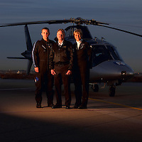 Members of North Memorial Hospital's AirCare helicopter service pose for a portrait in front of the helicopter on the 8th floor landing pad.