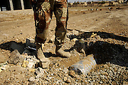 Iraqi army soldiers from the 2nd Battalion, 2nd Brigade, 5th Division, find an improvised explosive device during a four-day operation in New Baqubah, Iraq, on March 2, 2007. The purpose of the operation is to eliminate New Baqubah as an operating base for improvised explosive device building cells and key leaders of anti-Iraqi forces in Iraq.