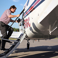 South Carolina head coach Will Muschamp boards the plane in Columbia, bound for SEC Media Days in Hoover, Alabama. ©Travis Bell Photography