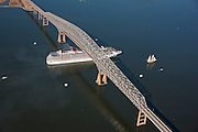 Aerial view of the Carnival Cruise Ship Pride with the Pride of Baltimore Sailing under Key Bridge.
