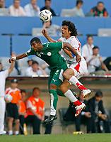 Photo: Glyn Thomas.<br />Tunisia v Saudi Arabia. Group H, FIFA World Cup 2006. 14/06/2006.<br /> Tunisia's Riadh Bouazizi (R) and Saudi Arabia's Khaled Aziz.