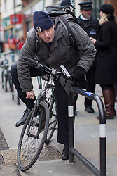 © licensed to London News Pictures. London, UK 25/03/2013.The Mayor of London Boris Johnson getting ready to cycle after joining members of the Dalston Safer Neighbourhood Team on their local beat to launch the Mayor's Police and Crime Plan on Dalston Kingsland High Street in London. Photo credit: Tolga Akmen/LNP