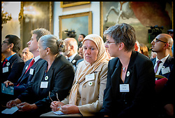 Image ©Licensed to i-Images Picture Agency. 08/07/2014. London, United Kingdom. Mejra Duguz (2nd right) a mother of Srebrenica  at the Srebrenica Memorial Reception at Lancaster House. Picture by Andrew Parsons / i-Images
