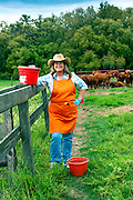 Portrait of Sandra Marvel with her dung beetle collecting buckets on Marvel Farms in High Springs, FL