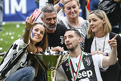 May 19, 2018 - Turin, Italy - Juventus defender Mattia De Sciglio (2) celebrates next to the Serie A soccer title trophy after the Serie A football match n.38 JUVENTUS - VERONA on 19/05/2018 at the Allianz Stadium in Turin, Italy. (Credit Image: © Matteo Bottanelli/NurPhoto via ZUMA Press)