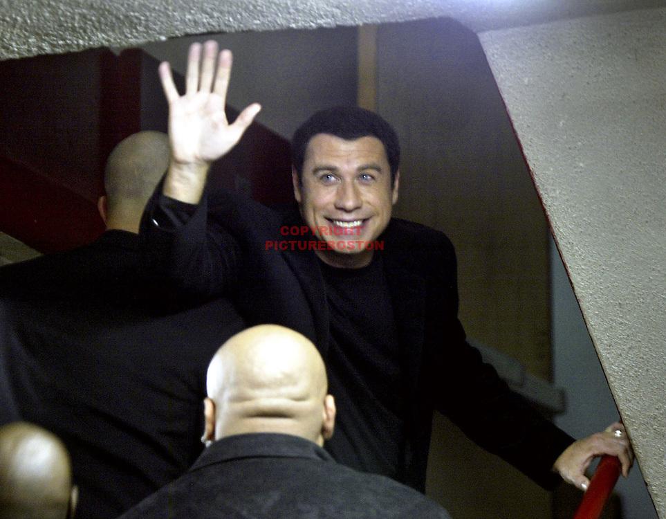 "(09/28/04-Boston, MA) John Travolta at Boston Fire Dept's Engine 33/Ladder 15 station. He and most of the cast of ""Ladder 49"" visited the station and travolta was presented this shirt. (092804travoltamg-Staff photo: Mark Garfinkel.savedwed/ Photo 6 .)"