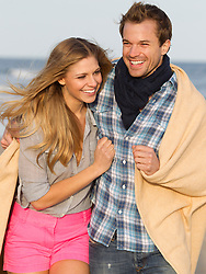 beautiful couple at the beach wearing comfortable clothing