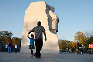 A father and daughter dance by the Martin Luther King, Jr. Memorial, on the 44th anniversary of King's assassination, in Washington, on Wednesday, April 4, 2012. (AP Photo/Jacquelyn Martin)