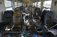 An abandoned train car filled with garbage, the soft padding of the seats cut out for use in migrant tents. Idomeni, Greece, March 25, 2016.