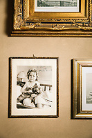 GARDONE RIVIERA, ITALY - 20 APRIL 2018: A signed portrait of Shirley Temple, who was a regular customer of the Grand Hotel Fasano as a child, is seen here in The Gin Bar of the hotel  in Gardone Riviera, Italy, on April 20th 2018.<br /> <br /> Lake Garda is the largest lake in Italy. It is a popular holiday location located in northern Italy, about halfway between Brescia and Verona, and between Venice and Milan on the edge of the Dolomites. The lake and its shoreline are divided between the provinces of Verona (to the south-east), Brescia (south-west), and Trentino (north).