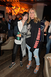 Left to right, LEAH WOOD and MEG MATTHEWS at the Fashion Targets Breast Cancer 20th Anniversary Party held at 100 Wardour Street, Soho, London on 12th April 2016.