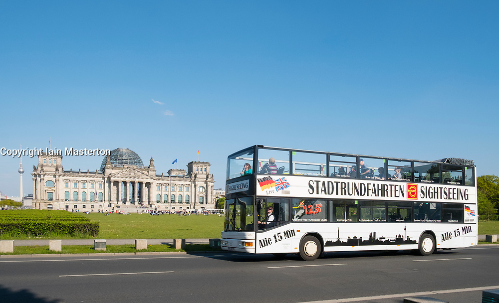Tourist sightseeing tour bus in front of the Reichstag in Berlin, Germany