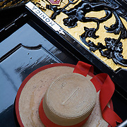 Gondolier's straw hat on top of gondola, Venice, Italy<br />