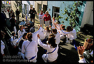 Teenage marchers bow to dying obby oss during children's morning parade on May Day in Padstow; Cornwall, England.