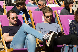 © Licensed to London News Pictures. 20/09/2019. London, UK. Office workers and tourists enjoying the autumn sunshine in deck chairs near St Paul's Cathedral in London this lunchtime.  Photo credit: Vickie Flores/LNP