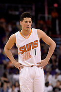 Apr 9, 2017; Phoenix, AZ, USA; Phoenix Suns guard Devin Booker (1) reacts on the court against the Dallas Mavericks in the first half of the NBA game at Talking Stick Resort Arena. Mandatory Credit: Jennifer Stewart-USA TODAY Sports