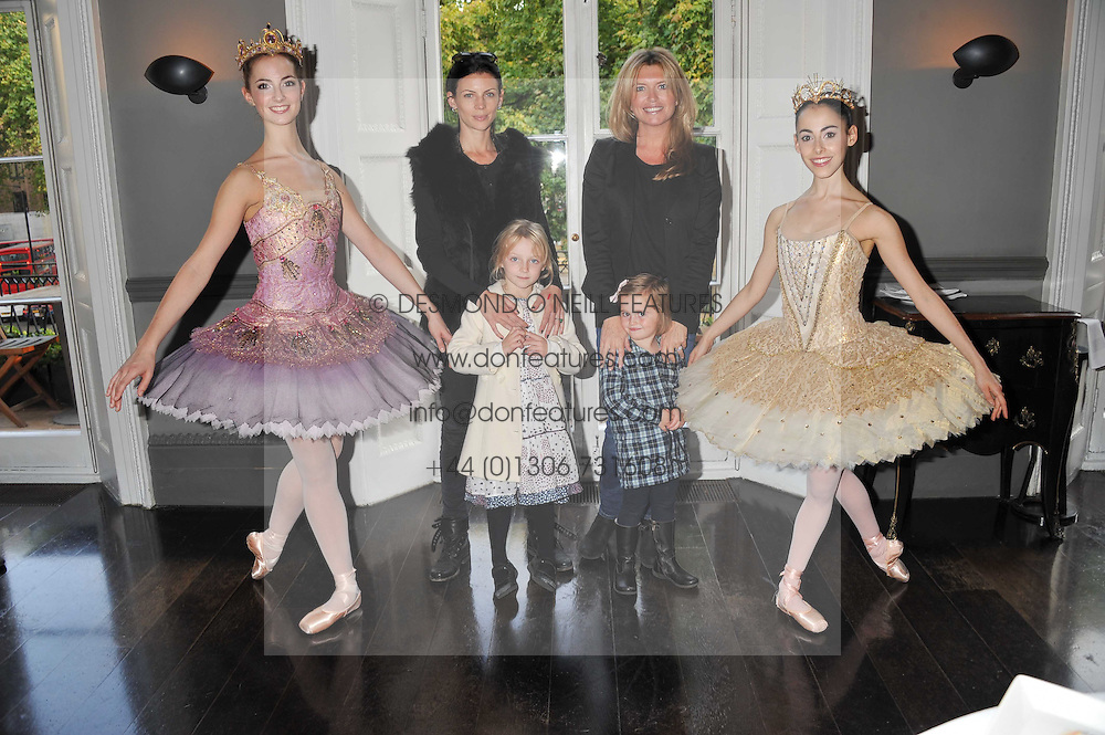 LIBERTY ROSS and her daughter SKLYA SAUNDERS, TINA HOBLEY and her daughter OLIVIA PARKER flanked by ballerinas at a children's tea party for the English National Ballet hosted by Mortons Private Members Club, Berkeley Square, London on 20th October 2011.