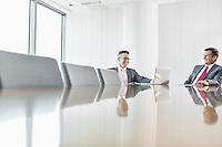 Smiling businessmen talking in conference room
