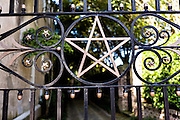 Decorative ironwork detail on the gate at 51 East Bay Street in historic Charleston, SC.