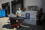 Nanosys employees recycle cardboard boxes and clean glass bottles at Nanosys in Milpitas, California, on October 16, 2014. (Stan Olszewski/SOSKIphoto)