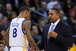 Jan 25, 2012; Oakland, CA, USA; Golden State Warriors head coach Mark Jackson (right) talks to shooting guard Monta Ellis (8) before the game against the Portland Trail Blazers at Oracle Arena. Golden State defeated Portland 101-93. Mandatory Credit: Jason O. Watson-US PRESSWIRE