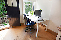 Interior of office with computer on desk