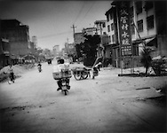 The crossroads Guangdong town, less than a generation ago, was a rural community.  Now it bustles with mercantile and manufactureing activity, between Guiyu and Shantou, Guangdong, China.